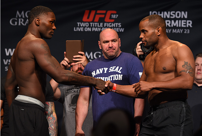 LAS VEGAS, NV - MAY 22:   (L-R) Opponents Anthony 'Rumble' Johnson and Daniel Cormier shake hands during the UFC 187 weigh-in at the MGM Grand Conference Center on May 2, 2015 in Las Vegas, Nevada. (Photo by Josh Hedges/Zuffa LLC/Zuffa LLC via Getty Image
