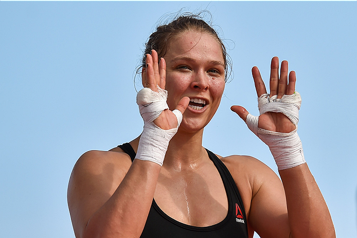 RIO DE JANEIRO, BRAZIL - JULY 29:  Womens bantamweight champion Ronda Rousey of the United States nods to fans during open training session at Pepe Beach on July 29, 2015 in Rio de Janeiro, Brazil.  (Photo by Buda Mendes/Zuffa LLC/Zuffa LLC via Getty Imag