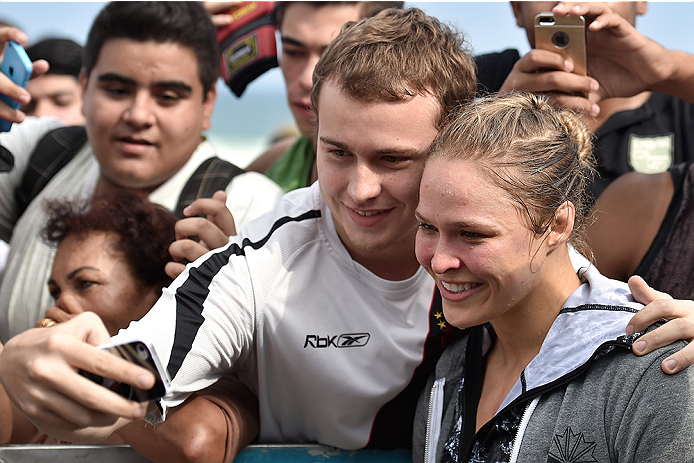 RIO DE JANEIRO, BRAZIL - JULY 29:  Womens bantamweight champion Ronda Rousey of the United States takes photos with fans during open training session at Pepe Beach on July 29, 2015 in Rio de Janeiro, Brazil.  (Photo by Buda Mendes/Zuffa LLC/Zuffa LLC via