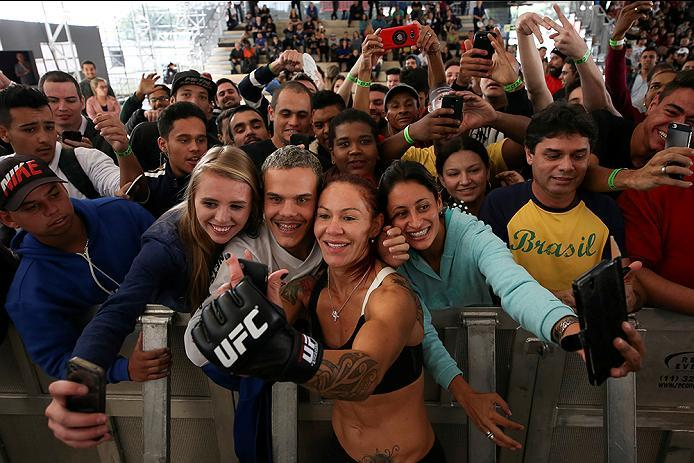 """RIO DE JANEIRO, BRAZIL - MAY 11: Catchweight Cris """"Cyborg"""" Justino of Brazil takes photos with fans during an open training session at Arena da Baixada stadium on May 11, 2016 in Curitiba, Brazil. (Photo by Buda Mendes/Zuffa LLC/Zuffa LLC via Getty Images"""