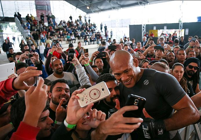 "RIO DE JANEIRO, BRAZIL - MAY 11: Middleweight contender Ronaldo 'Jacar��"" Souza of Brazil takes photos with fans during an open training session at Arena da Baixada stadium on May 11, 2016 in Curitiba, Brazil. (Photo by Buda Mendes/Zuffa LLC/Zuffa LLC via"