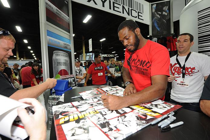 "LAS VEGAS, NV - JULY 06:  UFC light heavyweight champion Jon ""Bones"" Jones signs autographs for fans at UFC Fan Expo on July 6, 2012 in Las Vegas, Nevada. (Photo by Al Powers /Zuffa LLC/Zuffa LLC via Getty Images)"