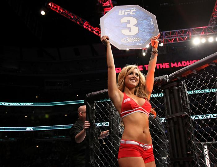 CHICAGO, IL - JANUARY 28:  UFC Octagon Girl Brittney Palmer introduces round 1 before the Camozzi vs Jacoby bout during the UFC on FOX event at United Center on January 28, 2012 in Chicago, Illinois.  (Photo by Josh Hedges/Zuffa LLC/Zuffa LLC via Getty Im
