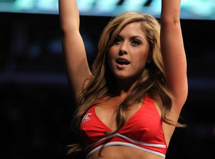 CHICAGO, IL - JANUARY 28:  UFC Octagon Girl Brittney Palmer introduces round two before the Johnson vs Roller bout during the UFC on FOX event at United Center on January 28, 2012 in Chicago, Illinois.  (Photo by Josh Hedges/Zuffa LLC/Zuffa LLC via Getty