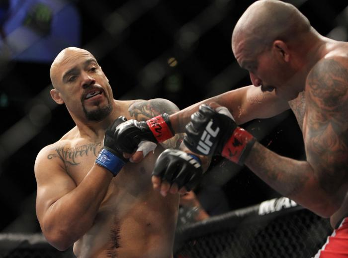 CHICAGO, IL - JANUARY 28:  (L-R) Lavar Johnson punches Joey Beltran during the UFC on FOX event at United Center on January 28, 2012 in Chicago, Illinois.  (Photo by Josh Hedges/Zuffa LLC/Zuffa LLC via Getty Images) *** Local Caption *** Lavar Johnson; Jo