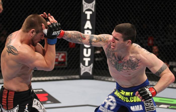 CHICAGO, IL - JANUARY 28:  (R-L) Chris Camozzi punches Dustin Jacoby during the UFC on FOX event at United Center on January 28, 2012 in Chicago, Illinois.  (Photo by Nick Laham/Zuffa LLC/Zuffa LLC via Getty Images) *** Local Caption *** Chris Camozzi; Du