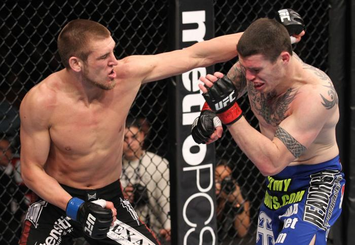 CHICAGO, IL - JANUARY 28:  (L-R) Dustin Jacoby punches Chris Camozzi during the UFC on FOX event at United Center on January 28, 2012 in Chicago, Illinois.  (Photo by Nick Laham/Zuffa LLC/Zuffa LLC via Getty Images) *** Local Caption *** Chris Camozzi; Du