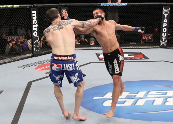 CHICAGO, IL - JANUARY 28:  (R-L) Dustin Jacoby and Chris Camozzi trade punches during the UFC on FOX event at United Center on January 28, 2012 in Chicago, Illinois.  (Photo by Nick Laham/Zuffa LLC/Zuffa LLC via Getty Images) *** Local Caption *** Chris C