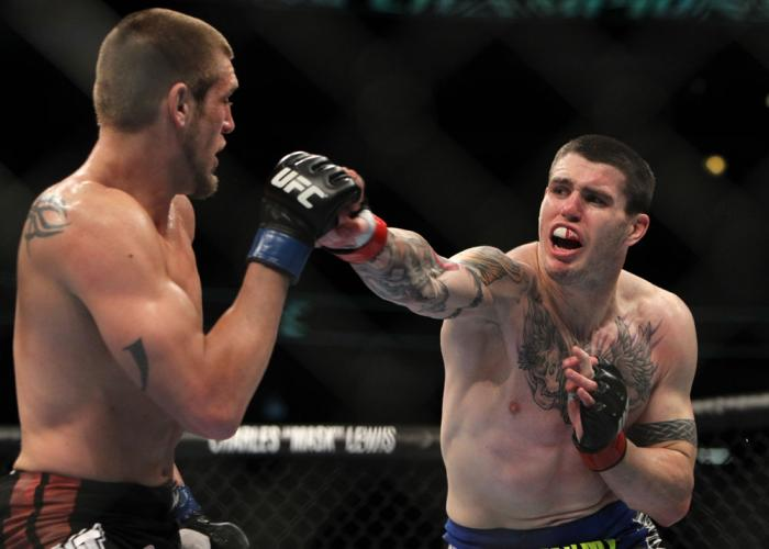 CHICAGO, IL - JANUARY 28:  (R-L) Chris Camozzi punches Dustin Jacoby during the UFC on FOX event at United Center on January 28, 2012 in Chicago, Illinois.  (Photo by Josh Hedges/Zuffa LLC/Zuffa LLC via Getty Images) *** Local Caption *** Chris Camozzi; D
