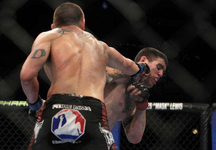 CHICAGO, IL - JANUARY 28:  (L-R) Dustin Jacoby punches Chris Camozzi during the UFC on FOX event at United Center on January 28, 2012 in Chicago, Illinois.  (Photo by Josh Hedges/Zuffa LLC/Zuffa LLC via Getty Images) *** Local Caption *** Chris Camozzi; D