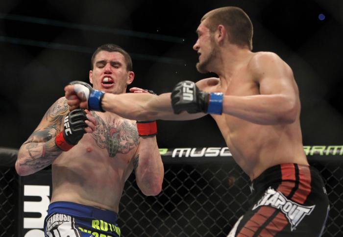 CHICAGO, IL - JANUARY 28:  (R-L) Dustin Jacoby punches Chris Camozzi during the UFC on FOX event at United Center on January 28, 2012 in Chicago, Illinois.  (Photo by Josh Hedges/Zuffa LLC/Zuffa LLC via Getty Images) *** Local Caption *** Chris Camozzi; D