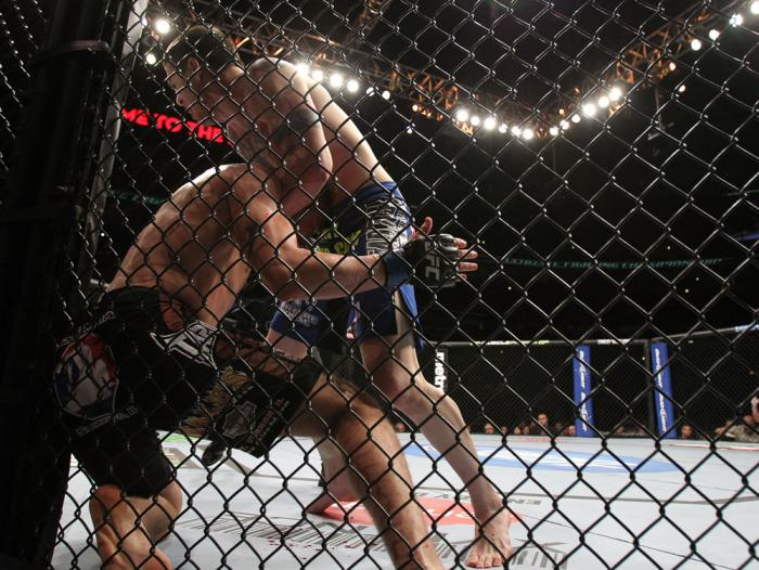 CHICAGO, IL - JANUARY 28:  (R-L) Chris Camozzi defeats Dustin Jacoby with a guillotine choke submission during the UFC on FOX event at United Center on January 28, 2012 in Chicago, Illinois.  (Photo by Josh Hedges/Zuffa LLC/Zuffa LLC via Getty Images) ***