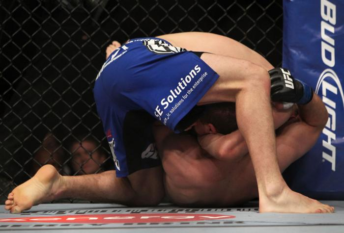CHICAGO, IL - JANUARY 28:  Evan Dunham (blue shorts) attempts a guillotine choke submission against Nik Lentz during the UFC on FOX event at United Center on January 28, 2012 in Chicago, Illinois.  (Photo by Josh Hedges/Zuffa LLC/Zuffa LLC via Getty Image