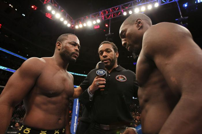CHICAGO, IL - JANUARY 28:  (L-R) Light Heavyweight opponents Rashad Evans and Phil Davis receive final instructions from referee Herb Dean before their bout during the UFC on FOX event at United Center on January 28, 2012 in Chicago, Illinois.  (Photo by