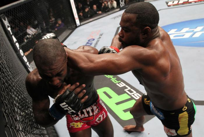 CHICAGO, IL - JANUARY 28:  (R-L) Rashad Evans punches Phil Davis during the UFC on FOX event at United Center on January 28, 2012 in Chicago, Illinois.  (Photo by Nick Laham/Zuffa LLC/Zuffa LLC via Getty Images) *** Local Caption *** Rashad Evans; Phil Da