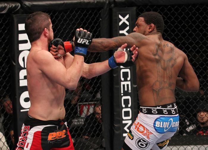 CHICAGO, IL - JANUARY 28:  (R-L) Michael Johnson punches Shane Roller during the UFC on FOX event at United Center on January 28, 2012 in Chicago, Illinois.  (Photo by Nick Laham/Zuffa LLC/Zuffa LLC via Getty Images) *** Local Caption *** Michael Johnson;