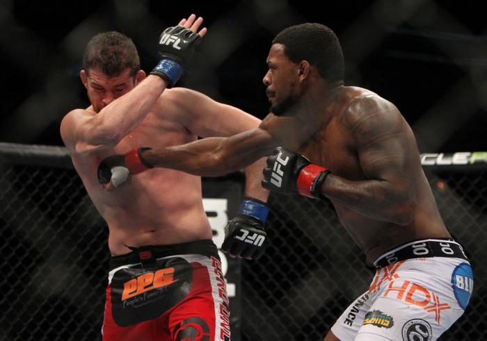 CHICAGO, IL - JANUARY 28:  (R-L) Michael Johnson punches Shane Roller during the UFC on FOX event at United Center on January 28, 2012 in Chicago, Illinois.  (Photo by Josh Hedges/Zuffa LLC/Zuffa LLC via Getty Images) *** Local Caption *** Michael Johnson