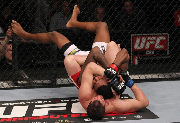 CHICAGO, IL - JANUARY 28:  (L-R) Shane Roller attempts a rear choke submission against Michael Johnson during the UFC on FOX event at United Center on January 28, 2012 in Chicago, Illinois.  (Photo by Nick Laham/Zuffa LLC/Zuffa LLC via Getty Images) *** L