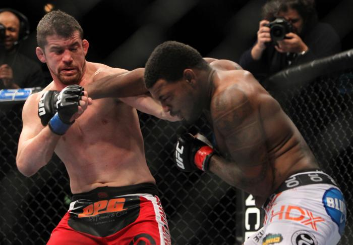 CHICAGO, IL - JANUARY 28:  (R-L) Michael Johnson and Shane Roller trade punches during the UFC on FOX event at United Center on January 28, 2012 in Chicago, Illinois.  (Photo by Josh Hedges/Zuffa LLC/Zuffa LLC via Getty Images) *** Local Caption *** Micha