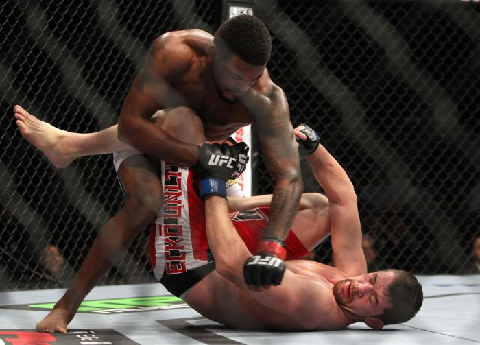 CHICAGO, IL - JANUARY 28:  (L-R) Michael Johnson punches Shane Roller during the UFC on FOX event at United Center on January 28, 2012 in Chicago, Illinois.  (Photo by Josh Hedges/Zuffa LLC/Zuffa LLC via Getty Images) *** Local Caption *** Michael Johnson