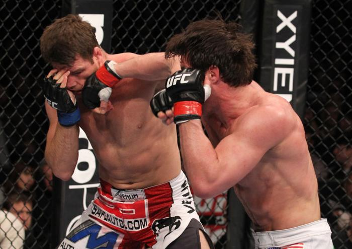 CHICAGO, IL - JANUARY 28:  (R-L) Chael Sonnen punches Michael Bisping during the UFC on FOX event at United Center on January 28, 2012 in Chicago, Illinois.  (Photo by Nick Laham/Zuffa LLC/Zuffa LLC via Getty Images) *** Local Caption *** Chael Sonnen; Mi