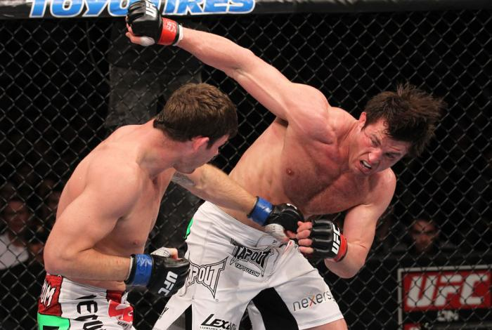 CHICAGO, IL - JANUARY 28:  (R-L) Chael Sonnen and Michael Bisping trade punches during the UFC on FOX event at United Center on January 28, 2012 in Chicago, Illinois.  (Photo by Nick Laham/Zuffa LLC/Zuffa LLC via Getty Images) *** Local Caption *** Chael