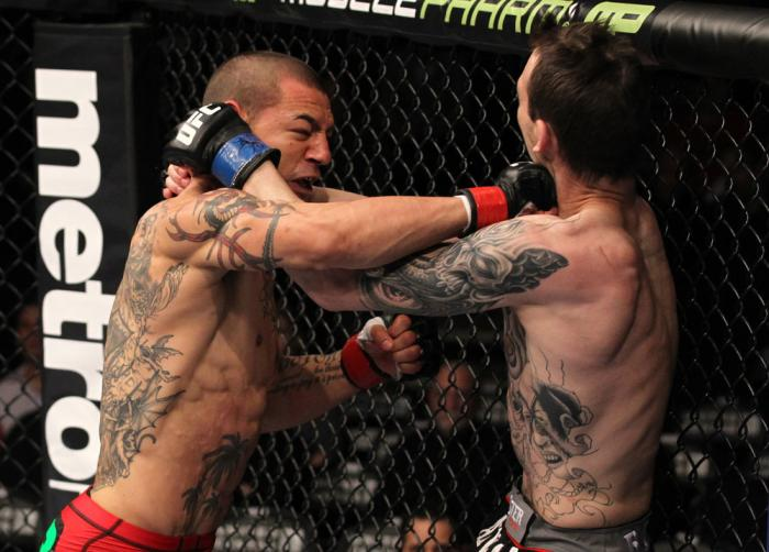 CHICAGO, IL - JANUARY 28:  (L-R) Cub Swanson punches George Roop during the UFC on FOX event at United Center on January 28, 2012 in Chicago, Illinois.  (Photo by Nick Laham/Zuffa LLC/Zuffa LLC via Getty Images) *** Local Caption *** George Roop; Cub Swan