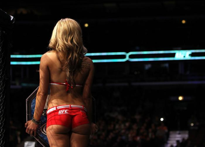 CHICAGO, IL - JANUARY 28:  UFC Octagon Girl Brittney Palmer introduces round three during the Russow vs Einemo bout during the UFC on FOX event at United Center on January 28, 2012 in Chicago, Illinois.  (Photo by Josh Hedges/Zuffa LLC/Zuffa LLC via Getty
