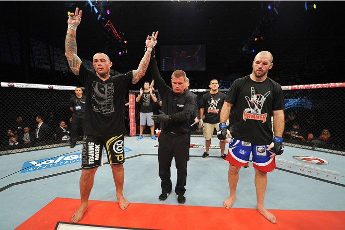 BARUERI, BRAZIL - OCTOBER 9:  (L-R) Thiago Silva celebrates after defeating Matt Hamill in their light heavyweight bout during the UFC Fight Night event at the Ginasio Jose Correa on October 9, 2013 in Barueri, Sao Paulo, Brazil. (Photo by Jeff Bottari/Zu