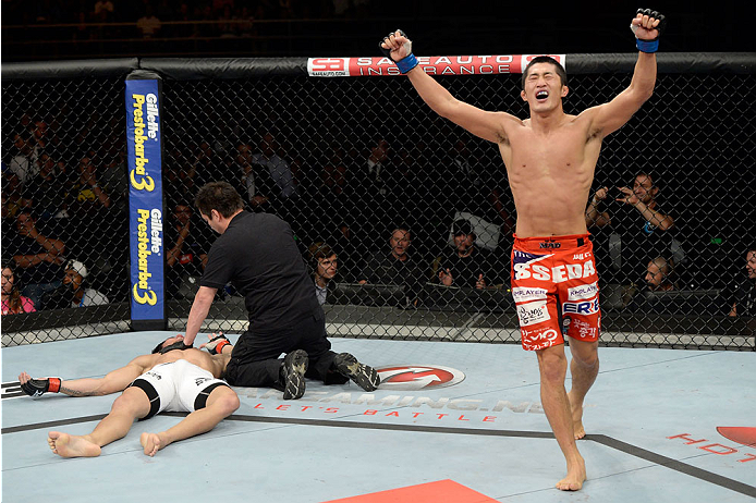 BARUERI, BRAZIL - OCTOBER 9:  (R-L) Dong Hyun Kim celebrates after knocking out Erick Silva in their welterweight bout during the UFC Fight Night event at the Ginasio Jose Correa on October 9, 2013 in Barueri, Sao Paulo, Brazil. (Photo by Jeff Bottari/Zuf