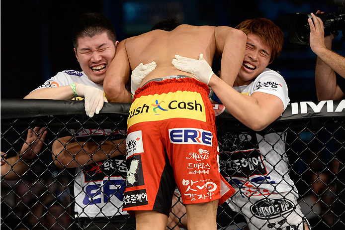 BARUERI, BRAZIL - OCTOBER 9:  Dong Hyun Kim celebrates with his corner after knocking out Erick Silva (not pictured) in their welterweight bout during the UFC Fight Night event at the Ginasio Jose Correa on October 9, 2013 in Barueri, Sao Paulo, Brazil. (
