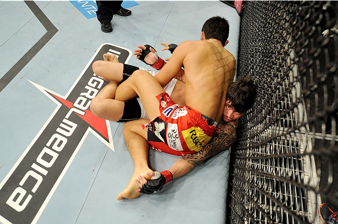 BARUERI, BRAZIL - OCTOBER 9:  Erick Silva lies pinned underneath Dong Hyun Kim (red shorts) in their welterweight bout during the UFC Fight Night event at the Ginasio Jose Correa on October 9, 2013 in Barueri, Sao Paulo, Brazil. (Photo by Jeff Bottari/Zuf