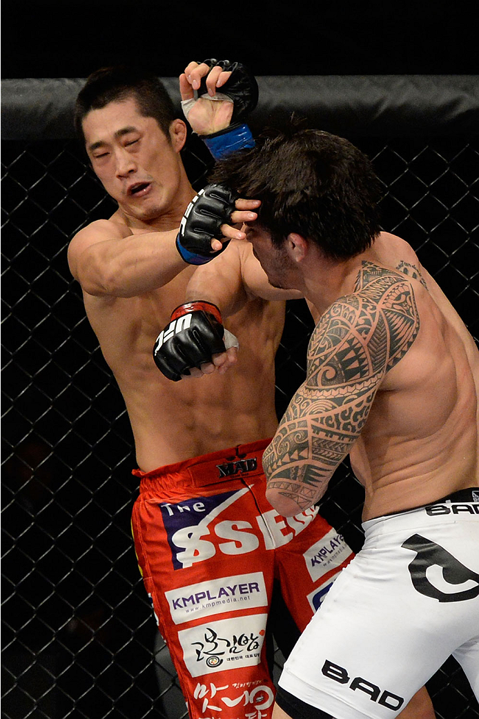 BARUERI, BRAZIL - OCTOBER 9:  (L-R) Dong Hyun Kim gets punched by Erick Silva in their welterweight bout during the UFC Fight Night event at the Ginasio Jose Correa on October 9, 2013 in Barueri, Sao Paulo, Brazil. (Photo by Jeff Bottari/Zuffa LLC/Zuffa L