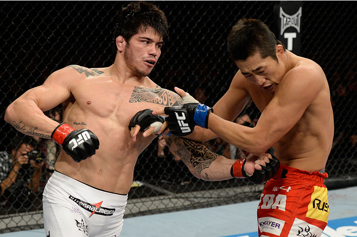 BARUERI, BRAZIL - OCTOBER 9:  (L-R) Erick Silva punches Dong Hyun Kim in their welterweight bout during the UFC Fight Night event at the Ginasio Jose Correa on October 9, 2013 in Barueri, Sao Paulo, Brazil. (Photo by Jeff Bottari/Zuffa LLC/Zuffa LLC via G