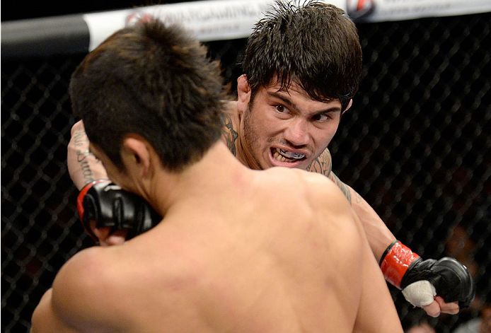 BARUERI, BRAZIL - OCTOBER 9:  (R-L) Erick Silva punches Dong Hyun Kim in their welterweight bout during the UFC Fight Night event at the Ginasio Jose Correa on October 9, 2013 in Barueri, Sao Paulo, Brazil. (Photo by Jeff Bottari/Zuffa LLC/Zuffa LLC via G