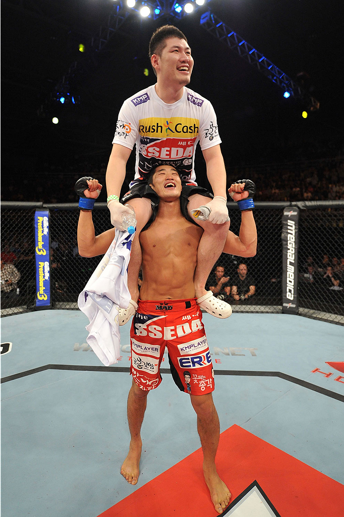 BARUERI, BRAZIL - OCTOBER 9:  Dong Hyun Kim (red shorts) celebrates with his corner after defeating Erick Silva (not pictured) in their welterweight bout during the UFC Fight Night event at the Ginasio Jose Correa on October 9, 2013 in Barueri, Sao Paulo,