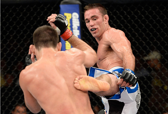 BARUERI, BRAZIL - OCTOBER 9:  (R-L) Jake Shields kicks Demian Maia in their welterweight bout during the UFC Fight Night event at the Ginasio Jose Correa on October 9, 2013 in Barueri, Sao Paulo, Brazil. (Photo by Jeff Bottari/Zuffa LLC/Zuffa LLC via Gett