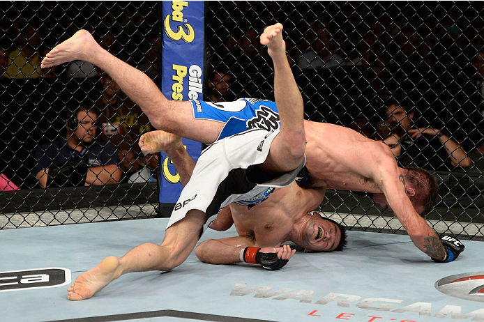 BARUERI, BRAZIL - OCTOBER 9:  Jake Shields (blue shorts) jumps on Demian Maia (white shorts) in their welterweight bout during the UFC Fight Night event at the Ginasio Jose Correa on October 9, 2013 in Barueri, Sao Paulo, Brazil. (Photo by Jeff Bottari/Zu