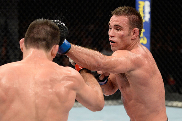 BARUERI, BRAZIL - OCTOBER 9:  (R-L) Jake Shields punches Demian Maia in their welterweight bout during the UFC Fight Night event at the Ginasio Jose Correa on October 9, 2013 in Barueri, Sao Paulo, Brazil. (Photo by Jeff Bottari/Zuffa LLC/Zuffa LLC via Ge