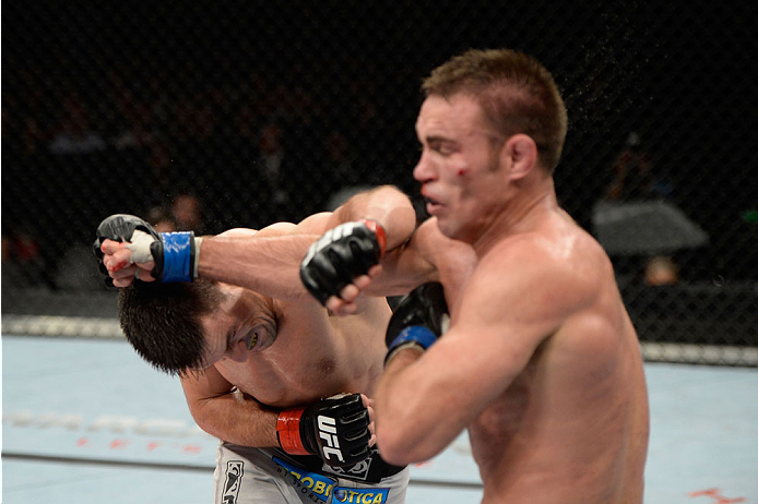 BARUERI, BRAZIL - OCTOBER 9:  (L-R) Demian Maia punches Jake Shields in their welterweight bout during the UFC Fight Night event at the Ginasio Jose Correa on October 9, 2013 in Barueri, Sao Paulo, Brazil. (Photo by Jeff Bottari/Zuffa LLC/Zuffa LLC via Ge