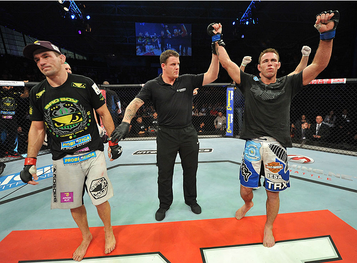 BARUERI, BRAZIL - OCTOBER 9:  (R-L) Jake Shields celebrates after defeating Demian Maia in their welterweight bout during the UFC Fight Night event at the Ginasio Jose Correa on October 9, 2013 in Barueri, Sao Paulo, Brazil. (Photo by Jeff Bottari/Zuffa L