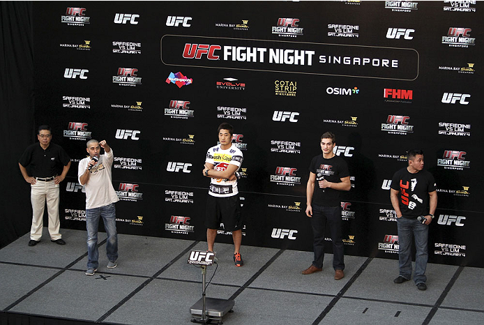 SINGAPORE - JANUARY 03:  (L to R) Jon Anik, Dong Hyun Kim, John Hathaway and Cung Le during the UFC Fight Night Singapore Q&A at the Shoppes at Marina Bay Sands on January 3, 2014 in Singapore. (Photo by Mitch Viquez/Zuffa LLC/Zuffa LLC via Getty Images)