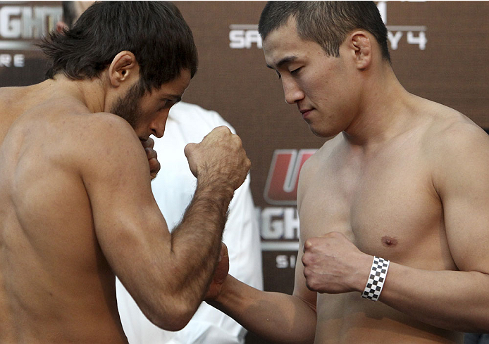 SINGAPORE - JANUARY 03:  (L and R) Mairbek Taisumov and Bang Tae Hyun face off during the UFC Fight Night Singapore Weigh-in at the Shoppes at Marina Bay Sands on January 3, 2014 in Singapore. (Photo by Mitch Viquez/Zuffa LLC/Zuffa LLC via Getty Images)
