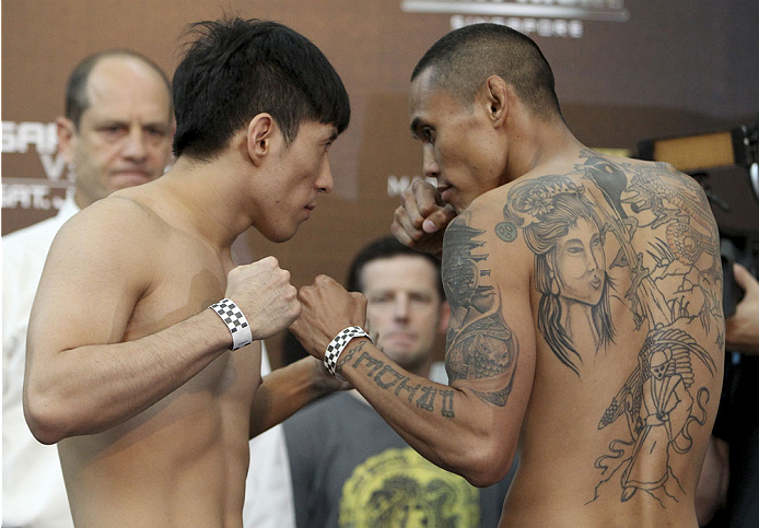 SINGAPORE - JANUARY 03:  (L and R) Royston Wee and David Galera face off during the UFC Fight Night Singapore Weigh-in at the Shoppes at Marina Bay Sands on January 3, 2014 in Singapore. (Photo by Mitch Viquez/Zuffa LLC/Zuffa LLC via Getty Images)