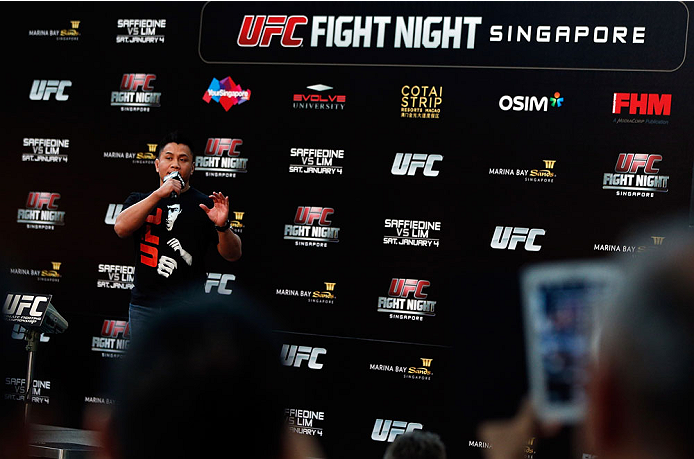 SINGAPORE - JANUARY 03:  Cung Le interacts with fans during a Q&A session before the UFC Fight Night Singapore Weigh-in at the Shoppes at Marina Bay Sands on January 3, 2014 in Singapore. (Photo by Josh Hedges/Zuffa LLC/Zuffa LLC via Getty Images)