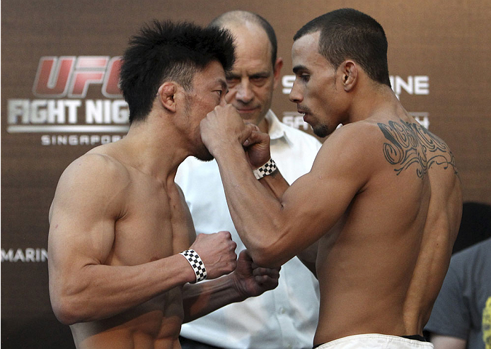 SINGAPORE - JANUARY 03: (L and R)  Tatsuya Kawajiri and Sean Soriano face off during the UFC Fight Night Singapore Weigh-in at the Shoppes at Marina Bay Sands on January 3, 2014 in Singapore. (Photo by Mitch Viquez/Zuffa LLC/Zuffa LLC via Getty Images)