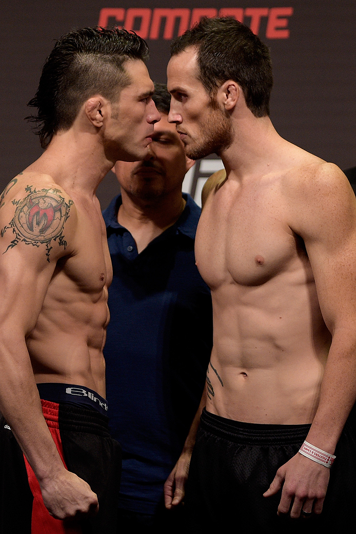 GOIANIA, BRAZIL - MAY 29: Featherweight fighters Rony Jason of Brazil and Damon Jackson of United States face off during the UFC Fight Night Weigh-ins at Goiania Arena on May 29, 2015 in Goiania, Brazil. (Photo by Buda Mendes/Zuffa LLC/Zuffa LLC via Getty