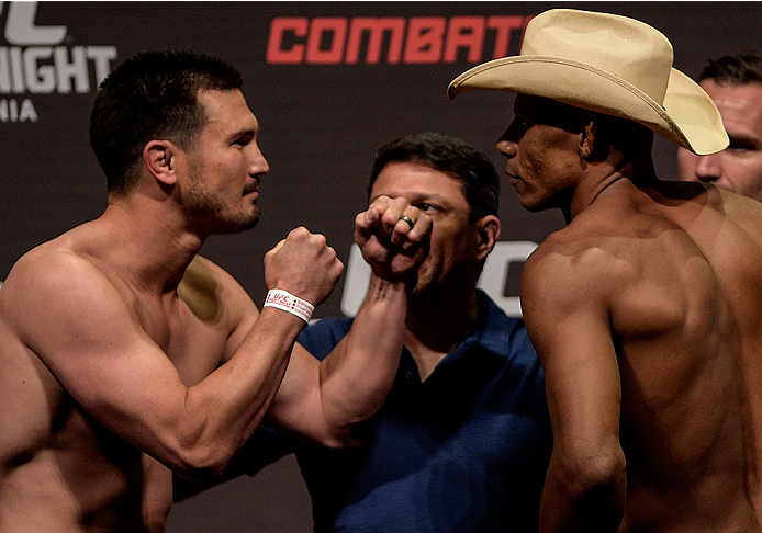 GOIANIA, BRAZIL - MAY 29: Welterweight fighter KJ Noons of the United States (L) and Alex Oliveira of Brazil face off during the UFC Fight Night Weigh-ins at Goiania Arena on May 29, 2015 in Goiania, Brazil. (Photo by Buda Mendes/Zuffa LLC/Zuffa LLC via G