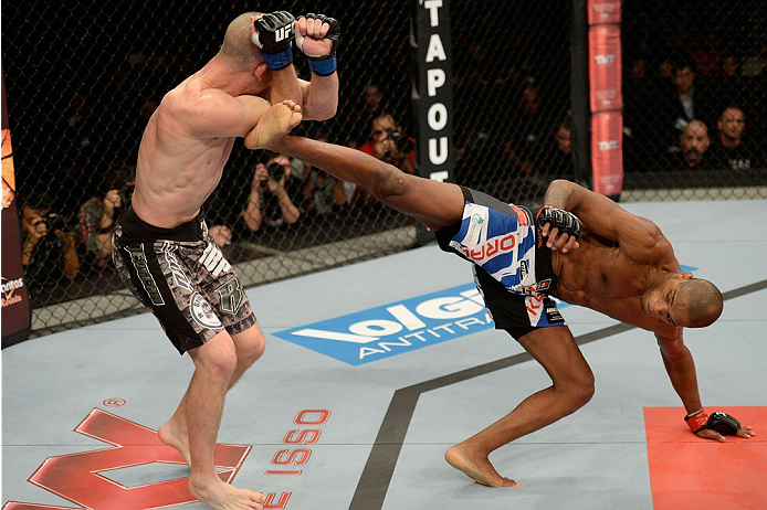 BARUERI, BRAZIL - OCTOBER 9:  (R-L) Alan Patrick kicks Garett Whiteley in their lightweight bout during the UFC Fight Night event at the Ginasio Jose Correa on October 9, 2013 in Barueri, Sao Paulo, Brazil. (Photo by Jeff Bottari/Zuffa LLC/Zuffa LLC via G