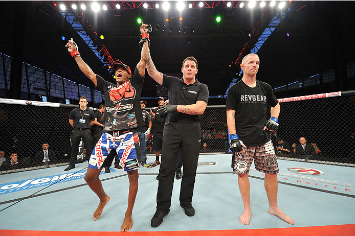 BARUERI, BRAZIL - OCTOBER 9:  (L-R) Alan Patrick celebrates after defeating Garett Whiteley in their lightweight bout during the UFC Fight Night event at the Ginasio Jose Correa on October 9, 2013 in Barueri, Sao Paulo, Brazil. (Photo by Jeff Bottari/Zuff
